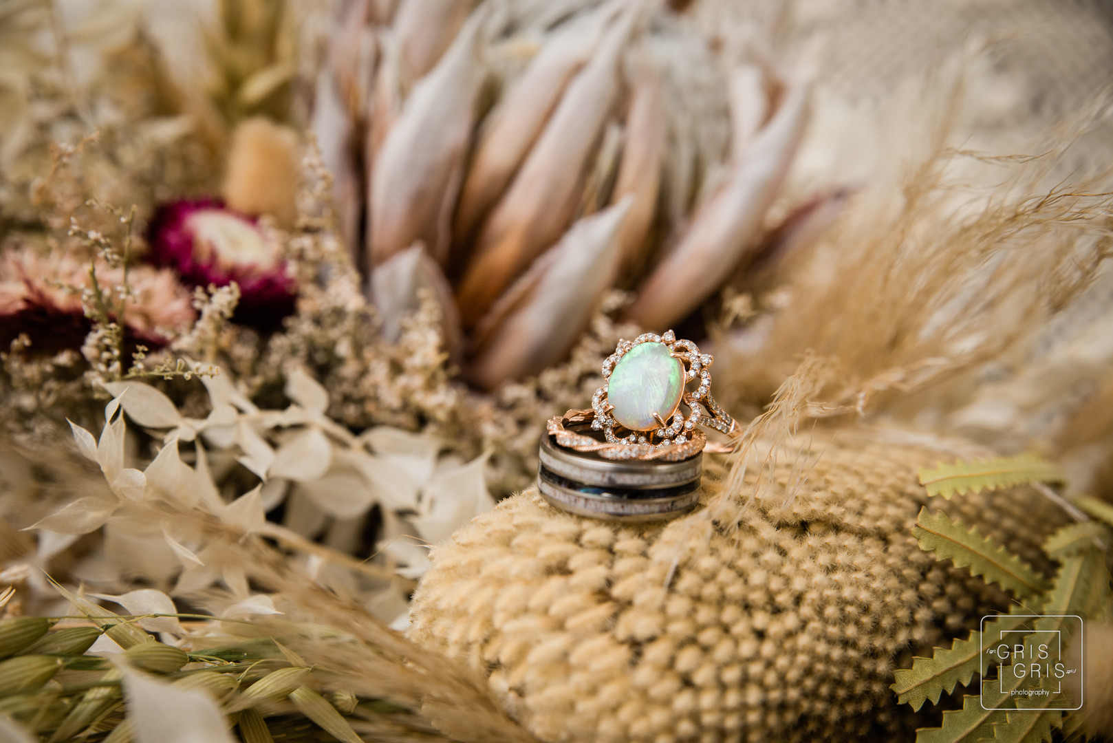 detail shot of wedding ring on dried flowers