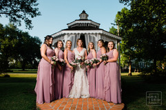 Bridal party portraits in front of gazebo