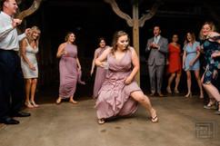 brides maid dances durring wedding reception