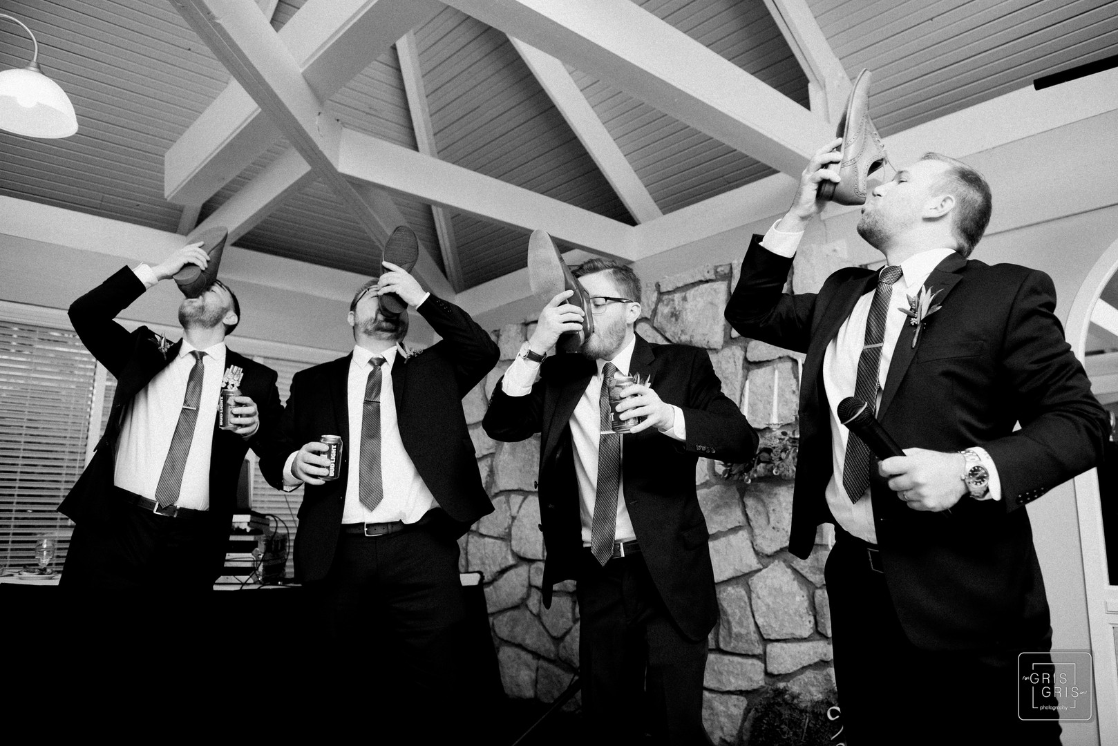 groomsmen toast by drinking beer out of shooes after best man speech durring wedding reception