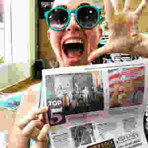 Brianne holds the Savannah Morning News. We are listed in their Top Five Things to do.