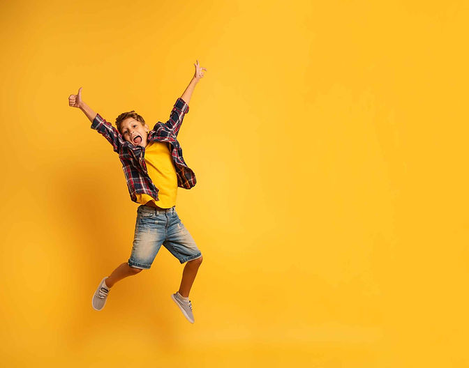 bx-happy-child-jumping-yellow-background