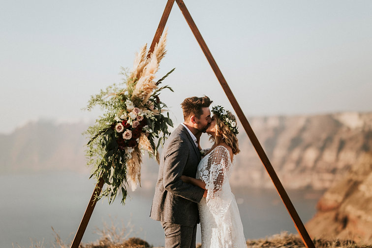 Greek Island elopement - triangle arch ceremony