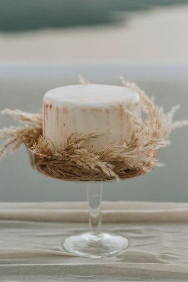 Greek Island elopement - pampas grass wedding cake