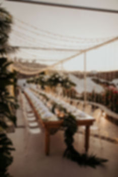 A magical Santorini destination wedding - fairy light dinner set up