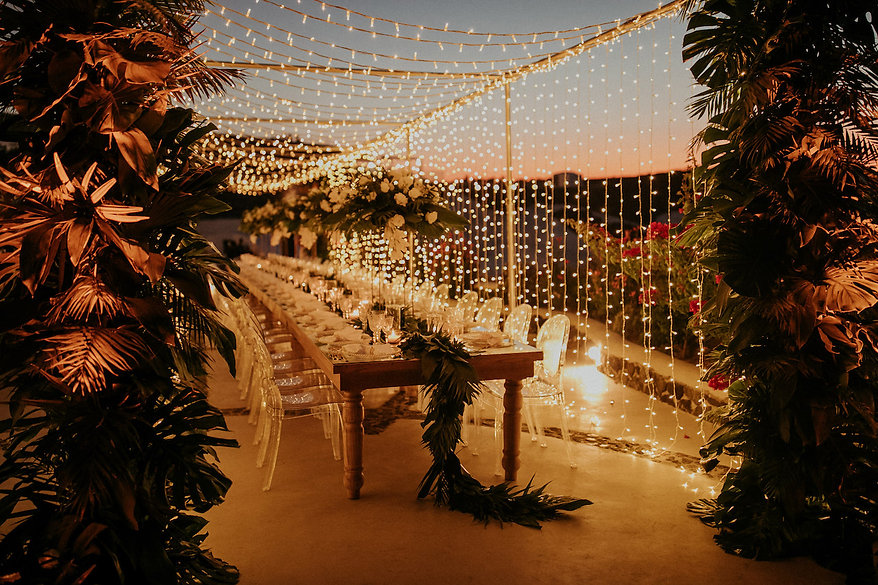 A magical Santorini destination wedding - fairy light dinner set up