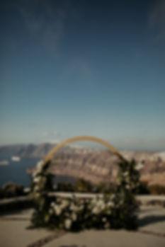 A magical Santorini destination wedding - Tropical ceremony arch