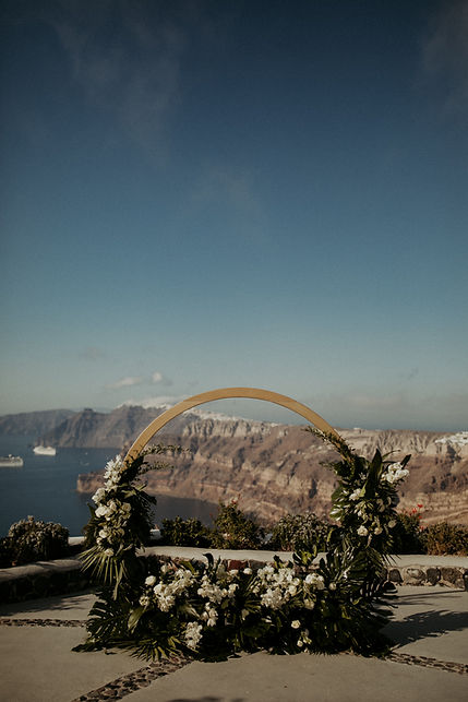 A magical Santorini destination wedding - Tropical ceremony arch