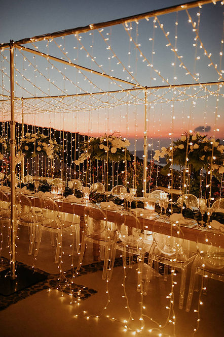 A magical Santorini destination wedding - fairy light dinner setting