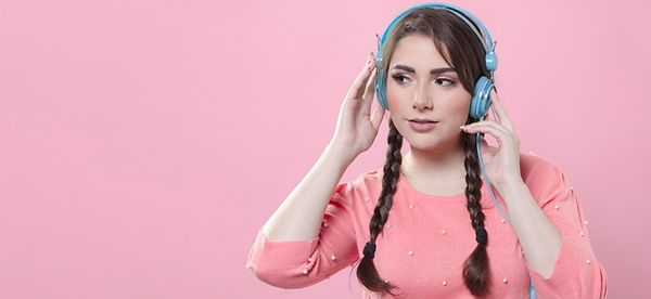 woman-listening-music-headphones-with-co