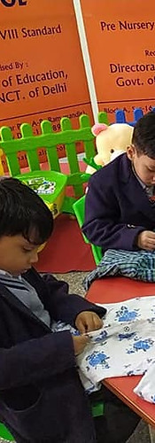 Grade- Mont. 2  Activity- Button your shirt  Working on gross motor skills helps a child gain strength and confidence in his/her body. It also helps them get exercise and physical activity, which is important for a healthy lifestyle. Developing these skills helps a childs ability to do more complex skills in future activities. Little hands need to develop dexterity and strength.