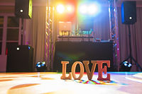 Love letters sign on the dance floor wit