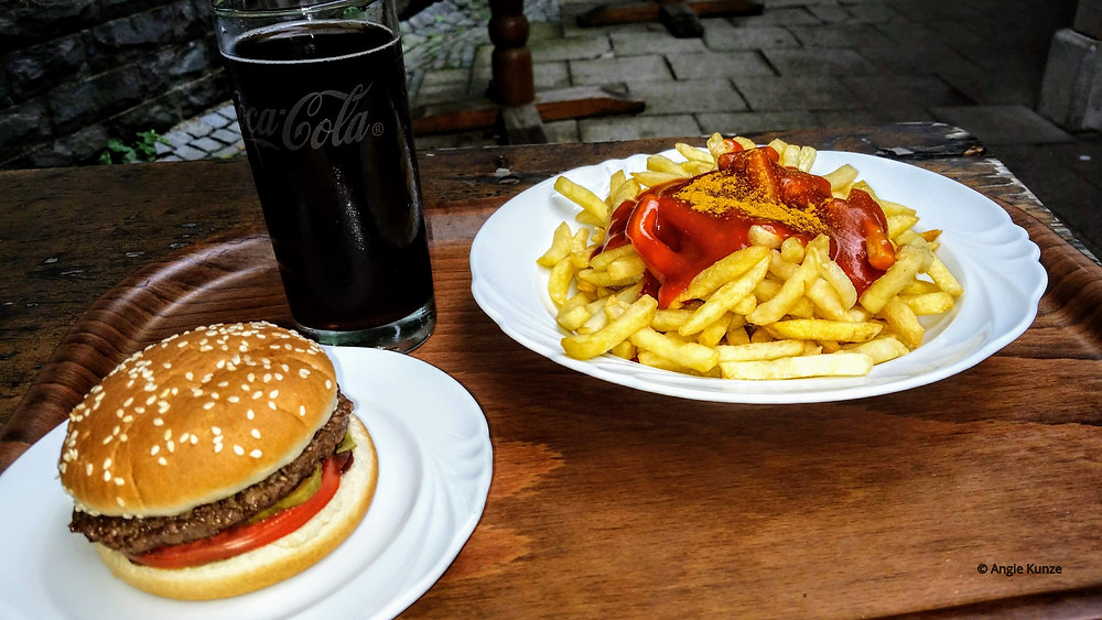 My Imbiss (snack) food: a hamburger and pommes mit curry and mayo, Neuschwanstein castle, Bavaria Germany, travel germany