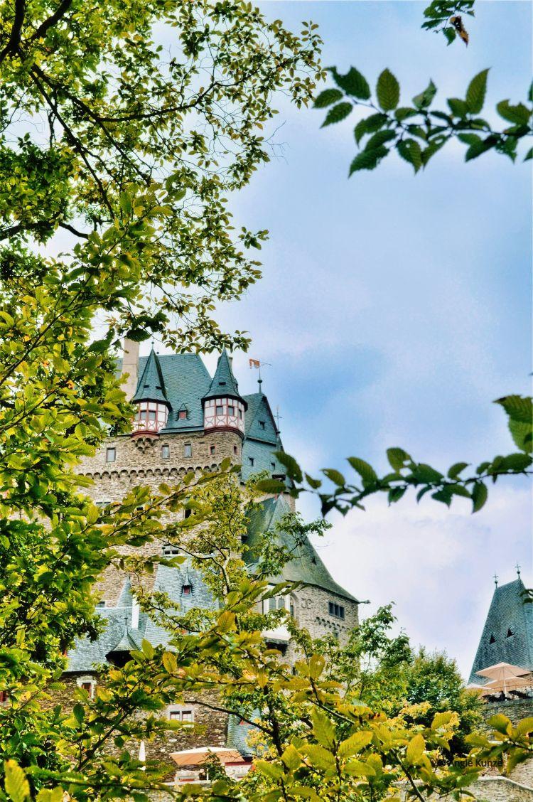 Berg Eltz Castle germany, through the trees, artistic view.