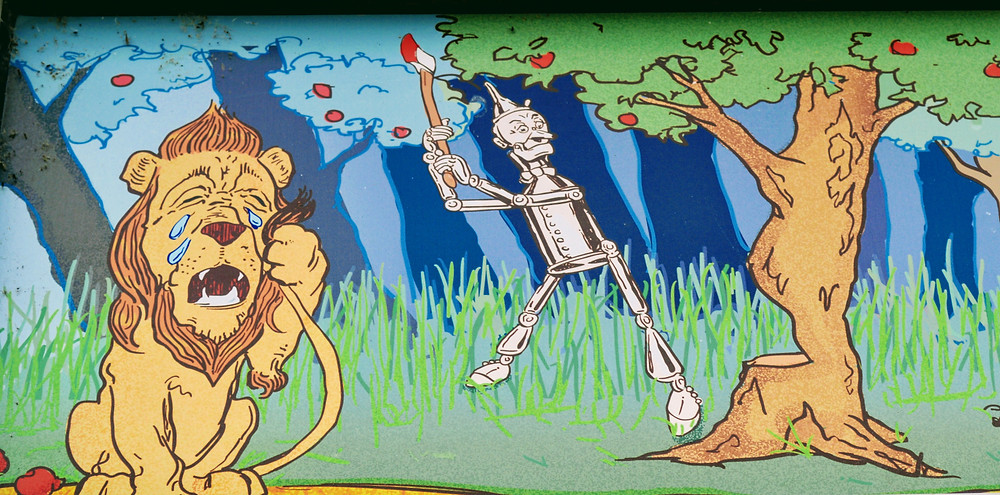 """Artwork exterior of the Oz Museum, Wamego Kansas """"Tin Man Chopping down a tree, The Cowardly Lion having a cry"""""""