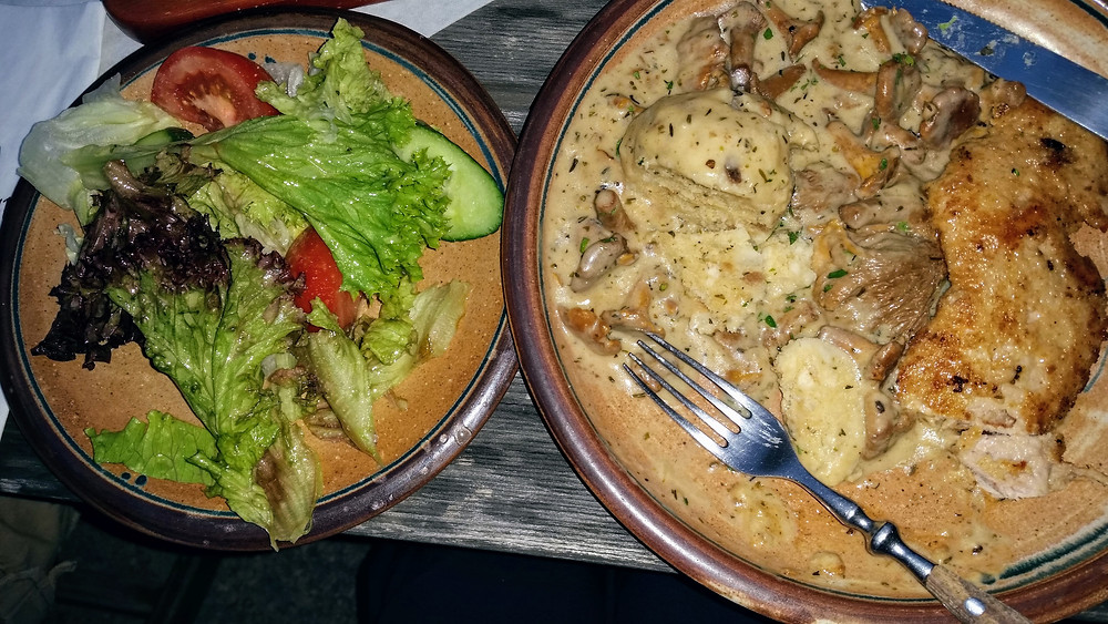pork with mushroom sauce dinner at zur holl restaurant in Rothenburg ob der Tauber, Bavaria Germany