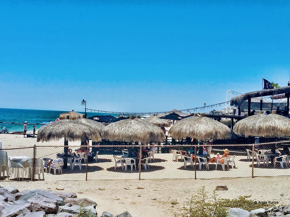 Tables in the sand on the beach, waterfront dining at wrecked at the reef restaurant on the beach in puerto penasco, Rocky Point, Mexico
