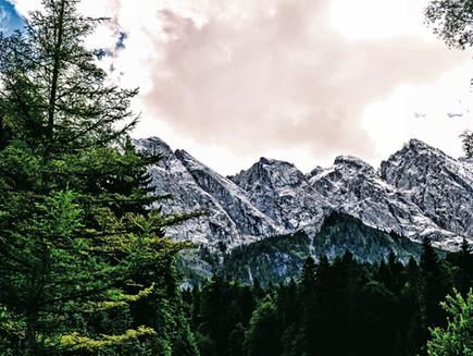Eibsee Lake, pretty in emerald green,  and the towering Zugspitze Mountain: Germany