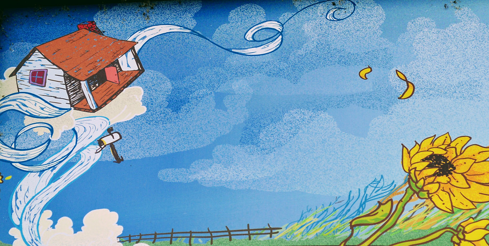 """artwork from the exterior of the Oz Museum, Wamego Kansas. """"blown away by the tornado."""""""