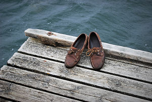 Old deck shoes on a pier