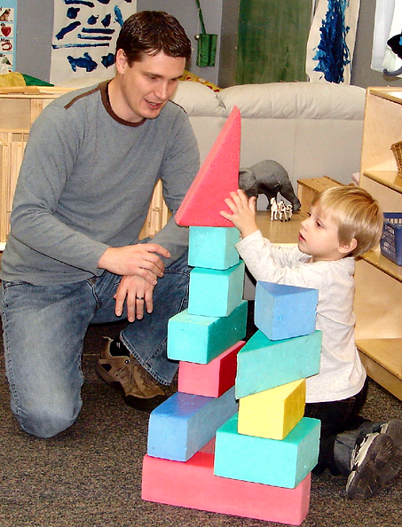 A boy and a man playing with blocks