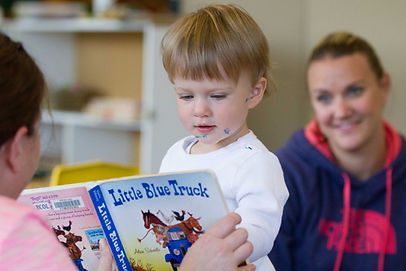 boy looking at a book