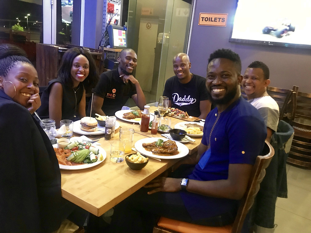Emmanuel having dinner with friends in Maseru, Lesotho after a conference