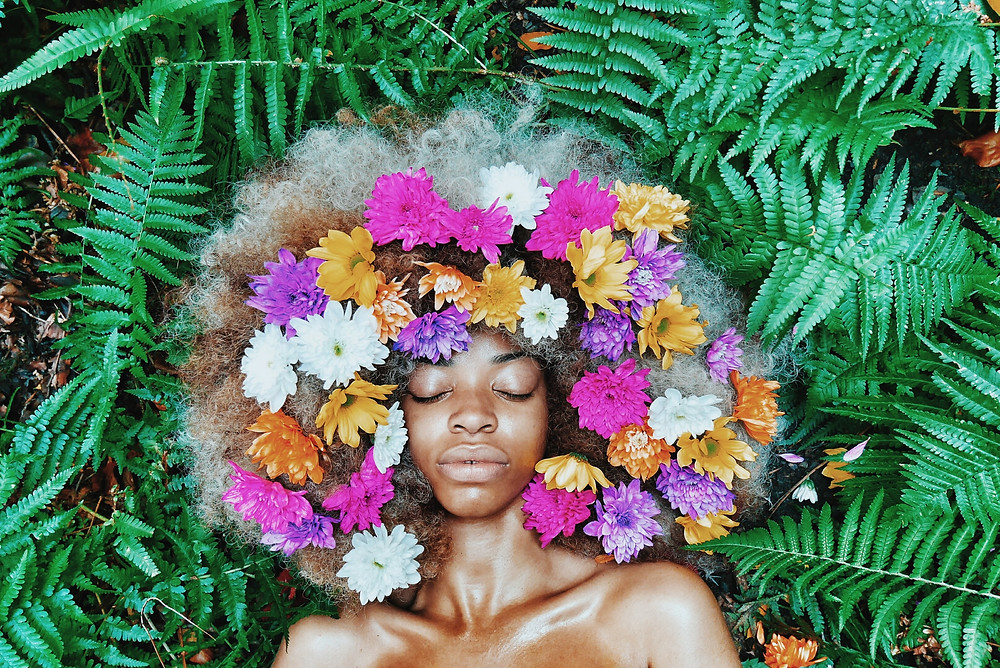 Woman with floral afro image by Ezekixl Akinnewu