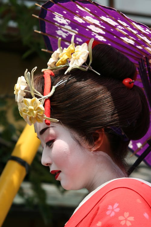 Japanese woman in traditional garb © Pexels