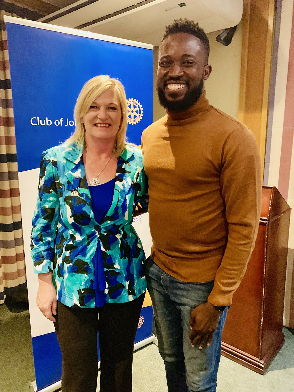 Emmanuel with Grace Van Zyl, president of the Rotary Club of Johannesburg