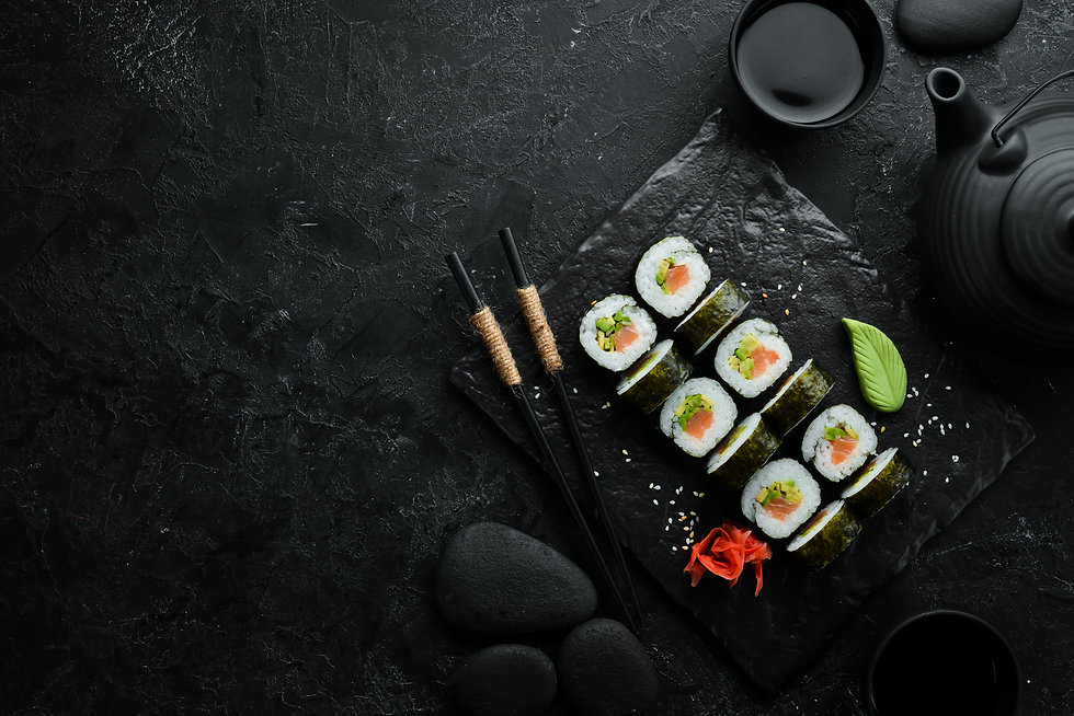 Sushi rolls with avocado and salmon. Cla
