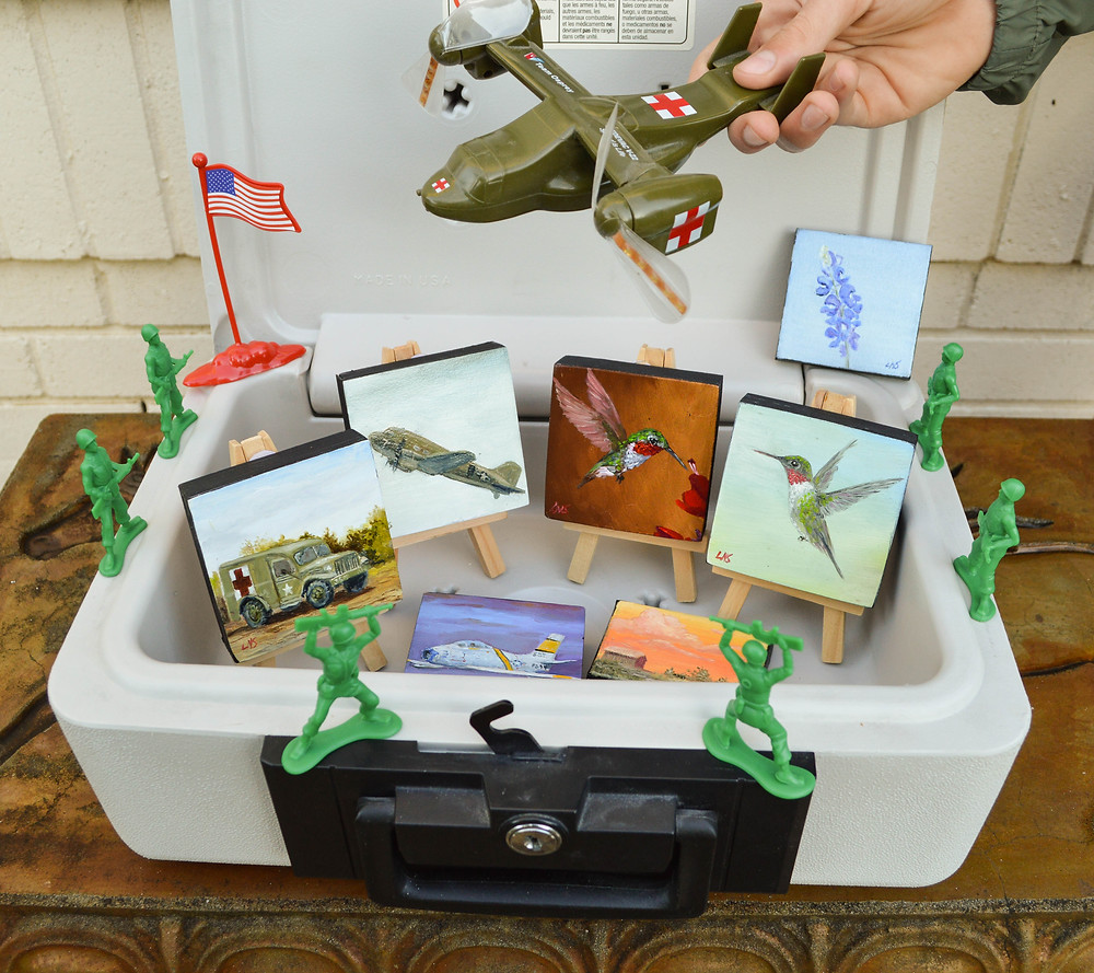 fireproof safe with petite paintings and toy soldiers