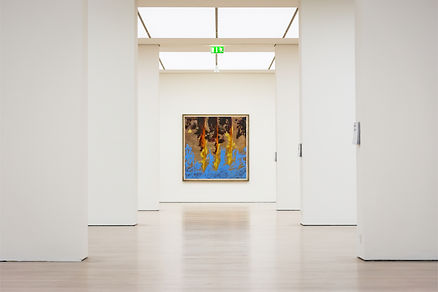 modern art painting with blue yellow and brown oil paints hanging in a white walled gallery by L. Nicholas Smith