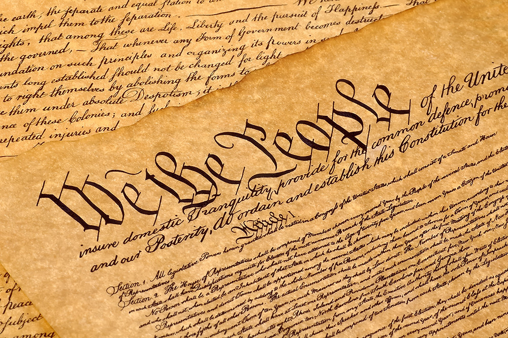 photo of sepia section of united states constitution highlighting we the people from oconnorinstitute used for blog on Silver Oak Art