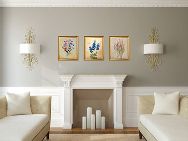 flower paintings by L. Nicholas Smith in gold frames hanging on wall in living room bluebonnets verbena and heather wildflowers