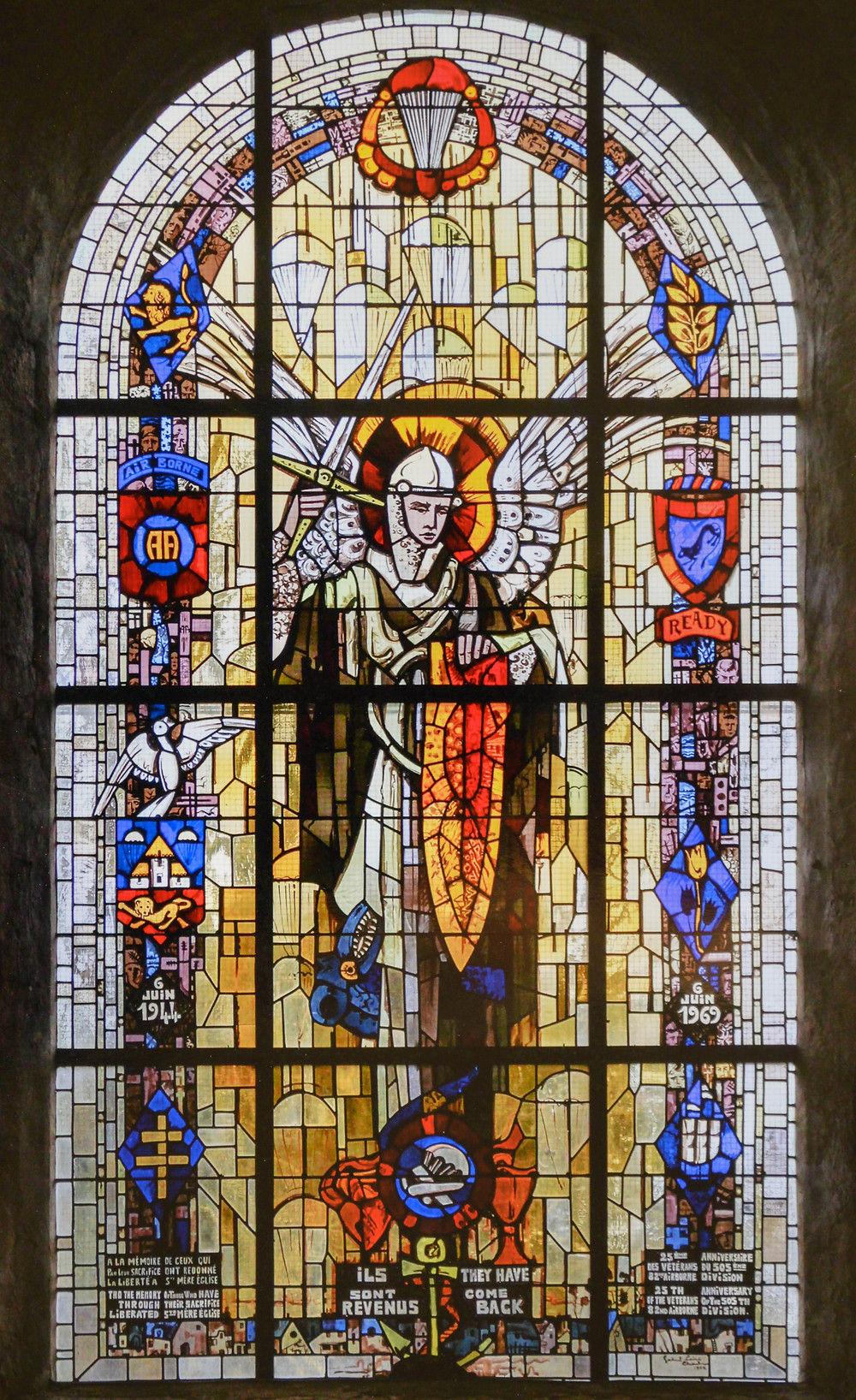 st. mere English stained glass window in france with st. michael patron saint of paratroopers copyright photo by brian guenthenspberger silveroakart