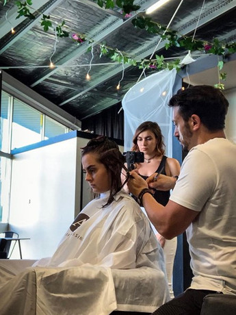 Brooke and Adam filming Youtube video in our salon May 2019