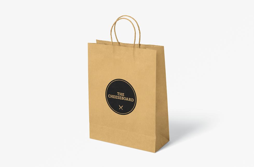 paper-bag-mockup-featuring-a-plain-color