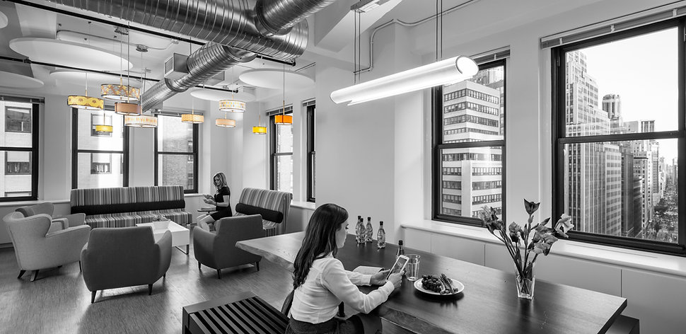The beautiful break room at this New York Advisory firm boasts a beautiful window line overlooking Broadway avenue. Designed by bldg in Washington DC. Commercial interior architecture in Washington DC.