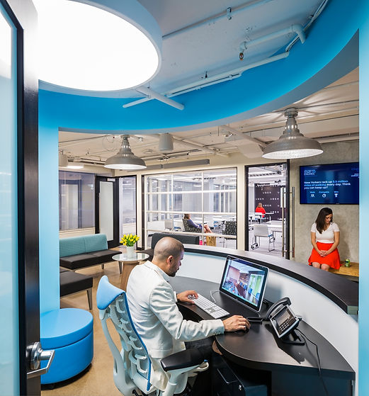 The reception desk of this Washington DC technology company has a custom built sem circle desk and a Herman Miller chair. The space was designed by Bill London Design Group.