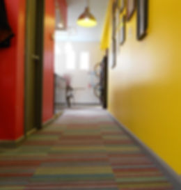 bldg's old office was painted in bright, primary colors.