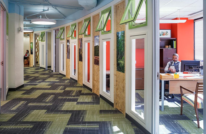 The Sustainable Forest Initiative integrated fiber and wood products. Particle board cabinets and tectum wood fiber ceiling. The space was designed by Bill London Design Group.