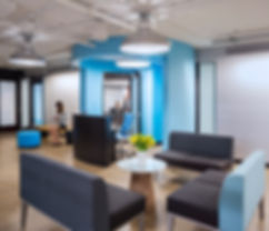 The lobby of this Washington DC technology project is inviting and comfortable with bright blues and modern furniture. This office space was designed by Bill London Design Group.
