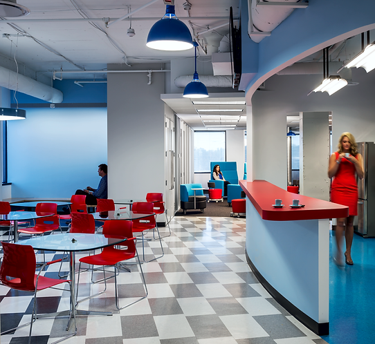 The lunchroom in Micropact's office is funky and cool with high contract blue, red and black.