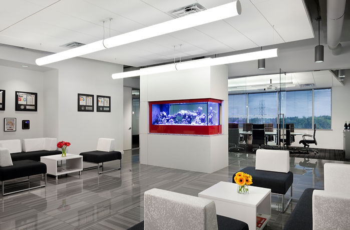 The lobby at Micropact's office is decorated in neutrals with a few pops of red. The office was designed by Bill London Design Group.