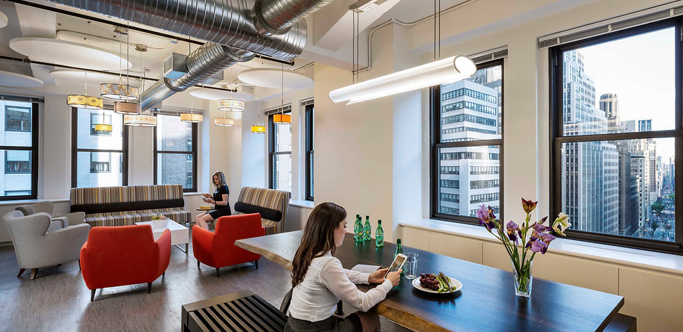 The beautiful conference and lunch room at this New York advisory firm has an amazing window line that overlooks Broadway St. This office was designed by Bill London Design Group.