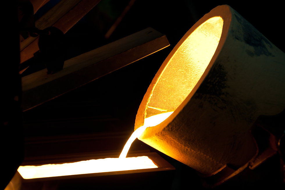Molten Gold being poured into Ingot moul