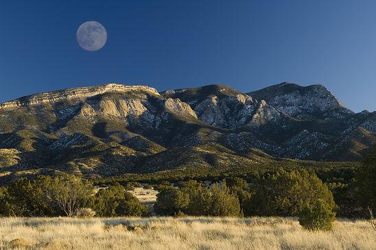Full moon rises over the Sandia mountain