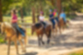 Atlanta Family enjoying a horseback trail ride at the stables at northeast georgia