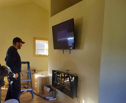 matt with fireplace and tv.jpg